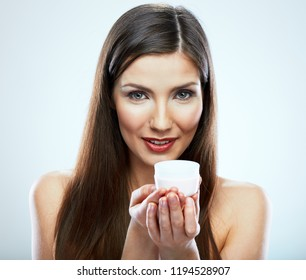 Woman holding white cream jar. Isolated beauty style close up portrait.