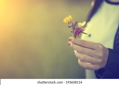 Woman holding wild flowers