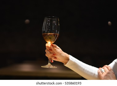 Woman holding a wine glass in restaurant