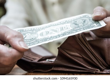 A woman holds a banknote in her hand