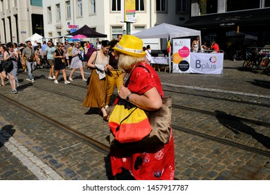 A woman holds a belgian flag on Belgian national day in Brussels, Belgium July 21, 2019.