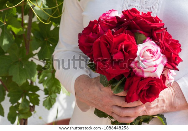 woman-holds-bouquet-freshly-picked-600w-