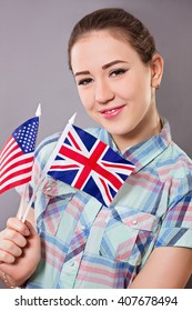 Woman holds british and american flag concept for learning english language