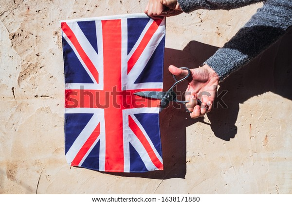 Woman holds a British flag during a brexit negotiations.
