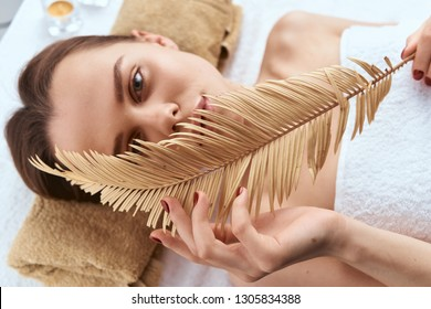 woman holds facial relax massage