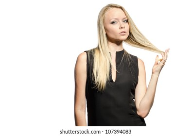 woman holds her hair