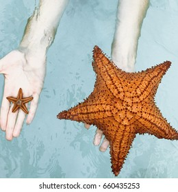 Woman holds in her hands little and big starfish