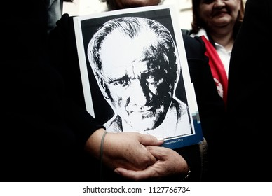 A Woman holds an image of Ataturk during a commeration ceremony in museum of founder of the Republic of Turkey Mustafa Kemal Ataturk in Thessaloniki, Greece on Nov. 10, 2013