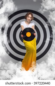 Woman holds a music disk in the hands. Music album. Musical vinyl record. Happy modern woman on the background of a circular target. Inscription on the t-shirt: things to do today: nothing.
