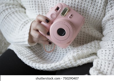Woman Holds Pink Instant Camera