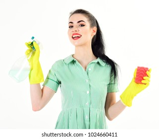 Woman holds sponge and household spray. Housewife with cheerful face, make up and cleaning supplies. Happy girl wearing household gloves isolated on white. Smile, cleaning service, hygiene concept.