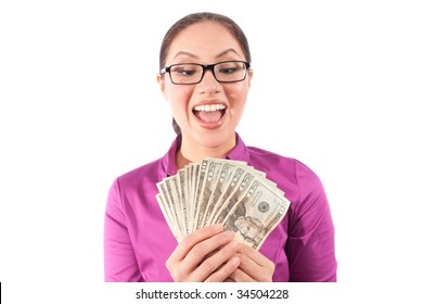 a woman holds up a wad of cash