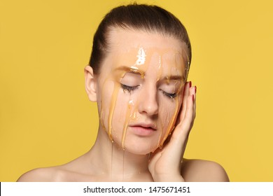 Woman with honey on her face. Honey treatment