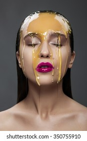 woman with a honey on her face and pink lips