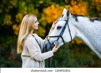 Woman with horse in park
