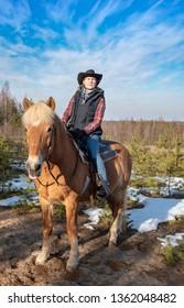 Woman horseback riding