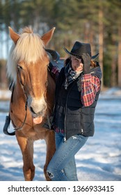 Woman horseback riding in forest
