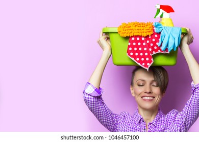 Woman with house supplies ready to clean room. Spring cleaning concept