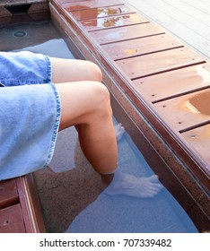 woman hovers her feet in the open city onsen at the bus stop Yonago,Japan