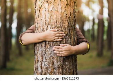 Woman hug the tree with love