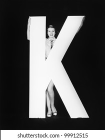 Woman with huge letter K