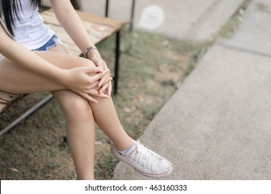 Woman Hugged Her Kneesgirl Sit With Ones Legs Crossedwaiting And Relaxing Concept
