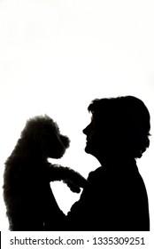 Woman Hugging Dog Silhouette in Studio