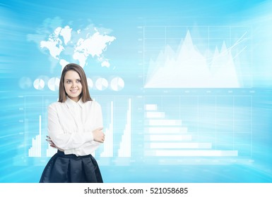 Woman hugging herself in a blue room with holographic images. Concept of the future and high tech. Double exposure. Elements of this image furnished by NASA