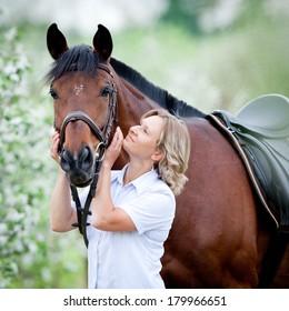Woman hugging a horse.
