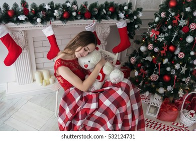 The woman is hugging teddy bear