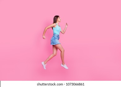 woman in a hurry, isolated on pink background