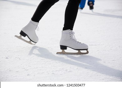 Woman ice skating on ice rink