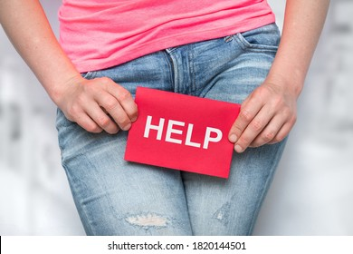 Woman with incontinence problem with HELP on paper - urinary incontinence concept