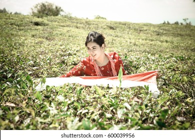 Woman with Indonesian Flag On The Tea Plantation