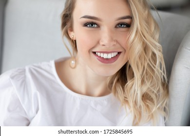 woman indoor portrait. Young beautiful smiling woman at home