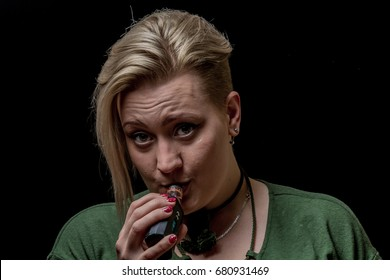 Woman inhaling from electronic cigarette