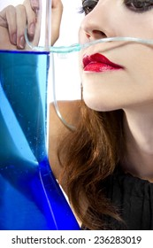 woman inhaling flavored oxygen with cannula and scented water