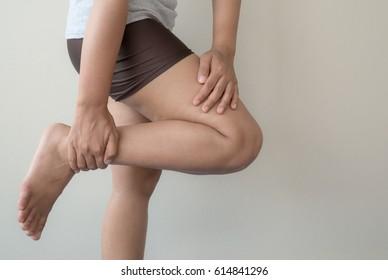 Woman injured leg with calf feeling pain .