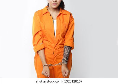 woman inmate using handcuff with tattoo. woman in handcuffs.