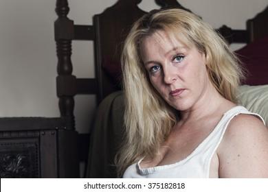 A woman inside is bedroom feel depress.
