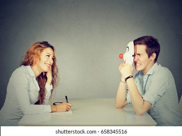 Woman interviewing new candidate for a job, a man pretender hiding his real personality