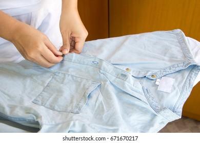 Woman ironing cloth on board