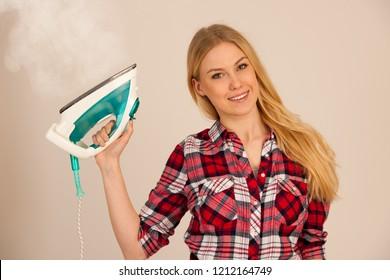woman ironing studio photo over white background