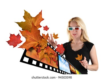A woman is isolated on a white background with leaves from a film real coming out to represent 3d television. The woman is wearing 3d glasses.