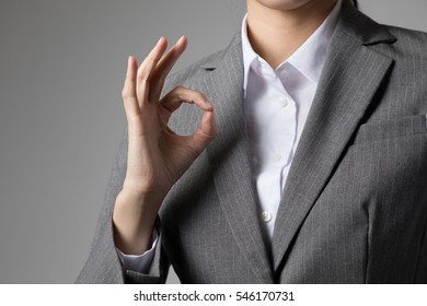 Woman issuing OK sign, okay, possible