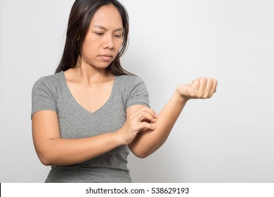 Woman itchy skin scratching her arm