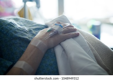 woman with iv in her hand in hospital. Labor and delivery preparation. Intravenious therapy infusion. shallow depth of field. selective focus