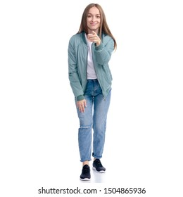 Woman in jeans coat jacket casual clothing standing smiling showing pointing on white background isolation