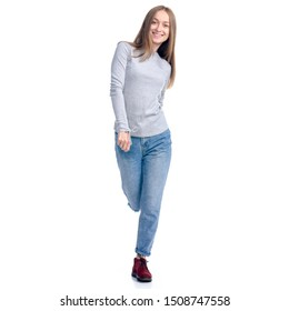 Woman in jeans and gray shirt smiling walking goes on white background isolation