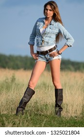 The woman in jeans shorts in field